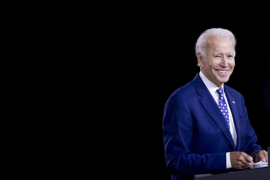 """Democratic presidential candidate former Vice President Joe Biden smiles at a campaign event at the William """"Hicks"""" Anderson Community Center in Wilmington, Del., Tuesday, July 28, 2020.(AP Photo/Andrew Harnik) ** FILE **"""