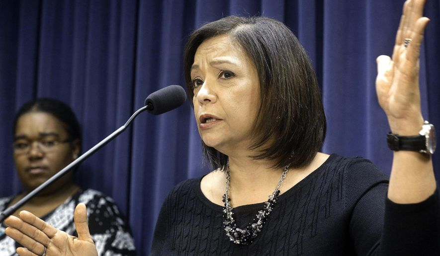 FILE - In this Jan. 13, 2016 file photo, Illinois Sen. Iris Martinez, D-Chicago, speaks during a news conference at the Illinois State Capitol in Springfield, Ill. On Thursday, July 30, 2020, Martinez, a Democratic National Committee officer, joined a growing number of legislators--all women--calling for Illinois House Speaker Michael Madigan to resign as speaker and party chairman in light of the federal ComEd investigation. (AP Photo/Seth Perlman File)