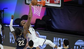 Utah Jazz's Rudy Gobert (27) is unable to score as New Orleans Pelicans' Derrick Favors (22) defends during the second half of an NBA basketball game Thursday, July 30, 2020, in Lake Buena Vista, Fla. (AP Photo/Ashley Landis, Pool)