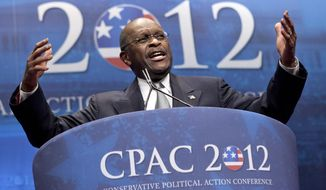 FILE - In this Feb. 9, 2012 file photo, former presidential candidate Herman Cain addresses the Conservative Political Action Conference in Washington.  Cain has died after battling the coronavirus. A post on Cain's Twitter account on Thursday, July 30, 2020 announced the death.   (AP Photo/J. Scott Applewhite, File)