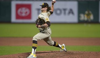 San Diego Padres pitcher Chris Paddack throws against the San Francisco Giants during the fifth inning of a baseball game in San Francisco, Wednesday, July 29, 2020. (AP Photo/Tony Avelar)