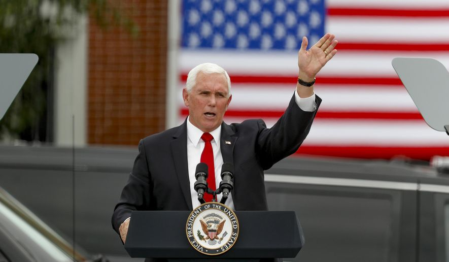"""Vice President Mike Pence waves after he spoke at a """"Cops for Trump"""" campaign event at the police station, Thursday, July 30, 2020, in Greensburg, Pa. (AP Photo/Keith Srakocic) ** FILE **"""