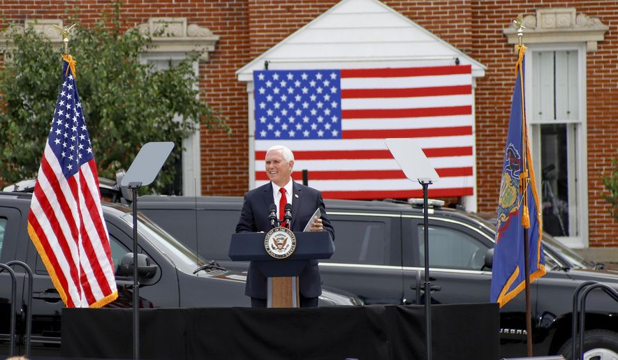 """Vice President Mike Pence speaks at a """"Cops for Trump"""" campaign event at the police station, Thursday, July 30, 2020, in Greensburg, Pa. (AP Photo/Keith Srakocic)"""