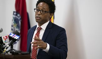 St. Louis County prosecuting attorney Wesley Bell announces Thursday, July 30, 2020, that no charges will be filed against former Ferguson, Mo., police officer Darren Wilson for shooting and killing Michael Brown Jr. on August 9, 2014 in Clayton, Mo. Bell said his administration reopened the case and spent five months reinvestigating.  (Chris Kohley/St. Louis Post-Dispatch via AP)