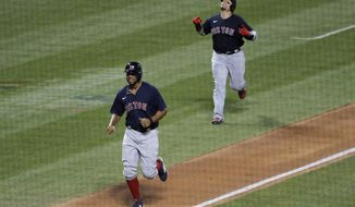 Christian Vazquez, right, and Xander Bogaerts celebrate as they approach home plate after Bogaerts hit a two-run homer run during the fourth inning of the baseball game against the New York Mets at Citi Field, Thursday, July 30, 2020, in New York. (AP Photo/Seth Wenig)
