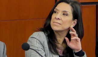 FILE - This undated file photo provided by the Rutgers Law School shows U.S. District Judge Esther Salas during a conference at the Rutgers Law School in Newark, N.J. On Sunday, July 19, 2020, a gunman posing as a FedEx delivery person went to Salas' North Brunswick, N.J., home and started shooting, wounding her husband, the defense lawyer Mark Anderl, and killing her son, Daniel Anderl. (Rutgers Law School via AP, File)