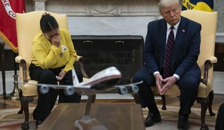 Gloria Guillen, the mother of slain Army Spc. Vanessa Guillen, meets with President Donald Trump in the Oval Office of the White House on Thursday, July 30, 2020, in Washington.
