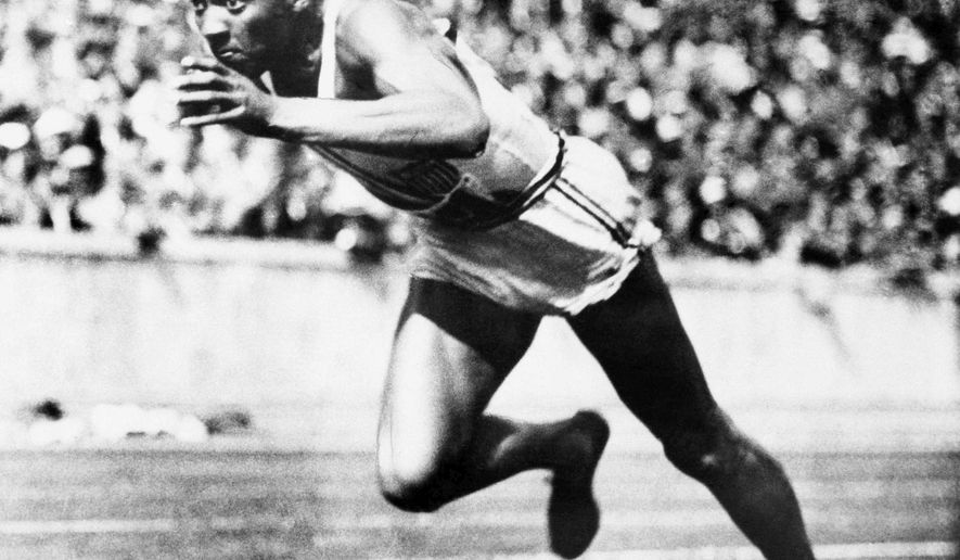 FILE - In this Aug. 14, 1936, file photo, American sprint star Jesse Owens is shown in action during one of the heats of the 200-meter run in Berlin. He won the final with a new Olympic record of 20.7 seconds. (AP Photo/File)
