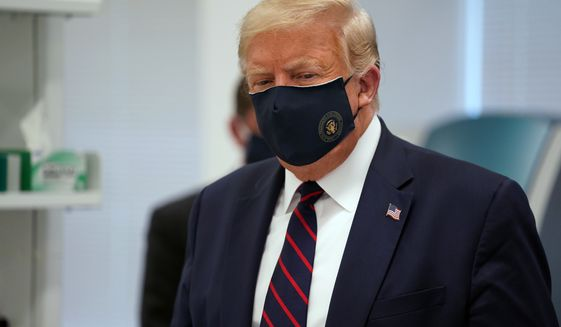 In this Monday, July 27, 2020, file photo, President Donald Trump wears a face mask as he participates in a tour at Fujifilm Diosynth Biotechnologies in Morrisville, N.C. (AP Photo/Evan Vucci) ** FILE **