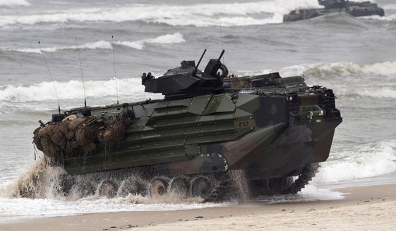 A U.S. Marine Amphibious Assault Vehicle (AAV) takes part in a landing operation during a military Exercise Baltops 2018, at the Baltic Sea near Vilnius, Lithuania, Monday, June 4, 2018. A training accident off the coast of Southern California in an AAV similar to this one has taken the life of one Marine, injured two others and left eight missing Thursday, July 30, 2020. In a Friday morning tweet, the Marines say the accident happened Thursday and search and rescue efforts are underway with support from the Navy and Coast Guard. (AP Photo/Mindaugas Kulbis, File)