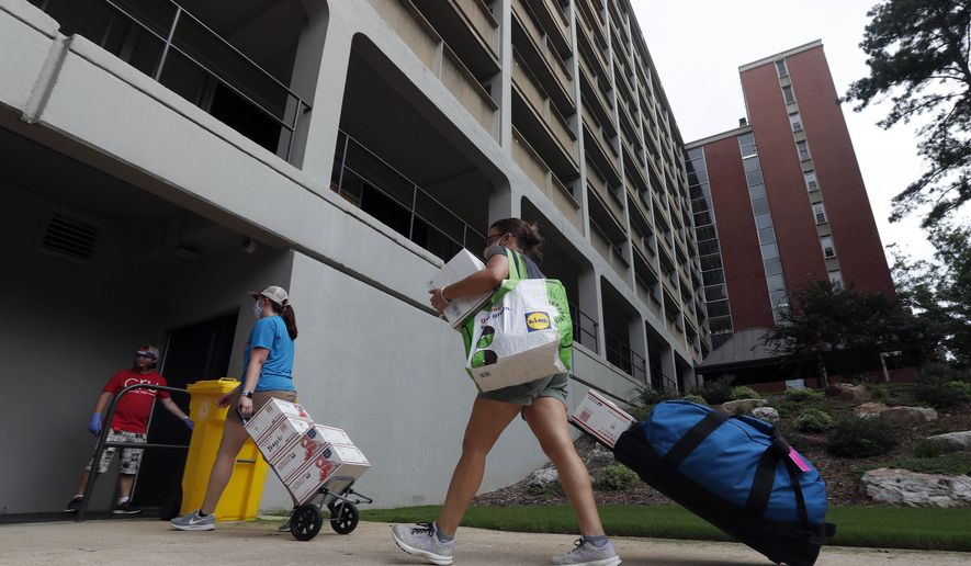 College students begin moving in for the fall semester at N.C. State University in Raleigh, N.C., Friday, July 31, 2020. (AP Photo/Gerry Broome)