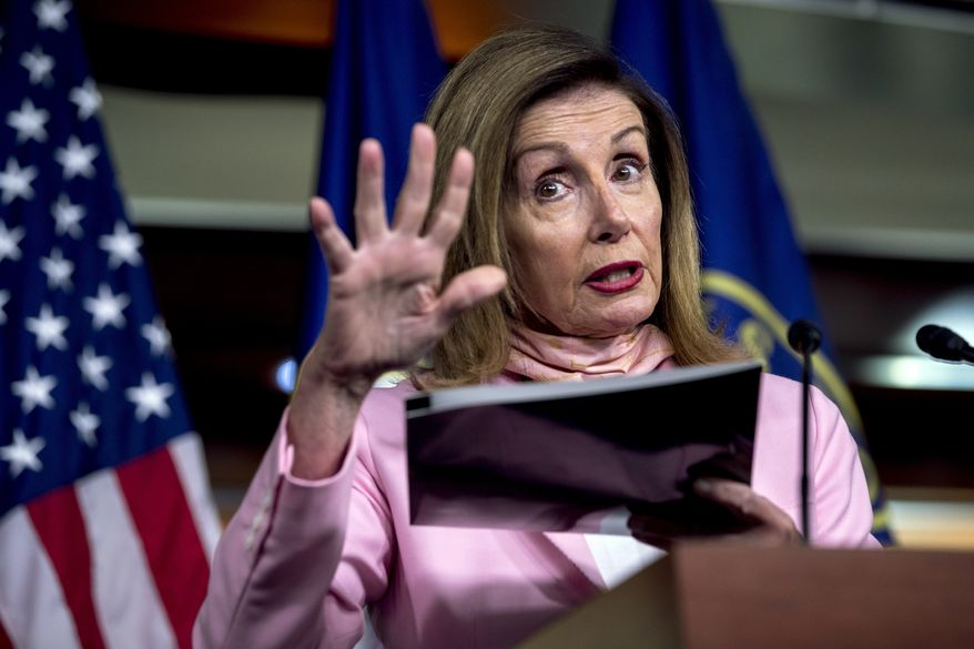 House Speaker Nancy Pelosi of Calif. uses a folder as a prop as she speaks about mail in voting during a news conference on Capitol Hill in Washington, Friday, July 31, 2020. (AP Photo/Andrew Harnik)