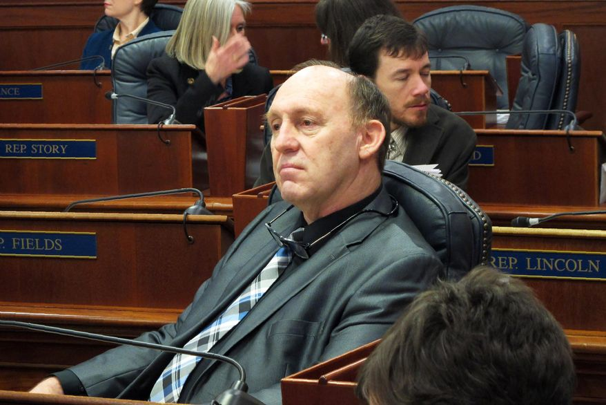 This Feb. 12, 2018, file photo, Alaska state Rep. Gary Knopp waits during a break in a floor session in which the House failed to elect a permanent speaker in Juneau, Alaska. The Alaska House Majority says Knopp was killed in the mid-air collision of two planes near Soldotna on Friday, July 31, 2020. Alaska State Troopers would not confirm Knopp's death beyond saying the mid-air collision near the airport in Soldotna was a fatal crash. (AP Photo/Becky Bohrer, File)