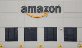 FILE - The Amazon DTW1 fulfillment center is shown in Romulus, Mich.  Amazon is heading to space. The online shopping giant received government approval to put more than 3,200 satellites into orbit that would beam down internet service to earth. Amazon said the satellites could provide internet to parts of the world that don't have it.   (AP Photo/Paul Sancya, File)