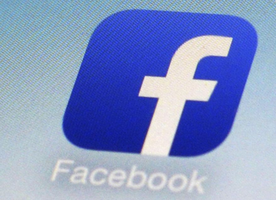 FILE - This Feb. 19, 2014, file photo, shows a Facebook app icon on a smartphone in New York. The Australian government said on Friday, July 31, 2020 it plans to give Google and Facebook three months to negotiate with Australian media businesses fair pay for news content.  (AP Photo/Patrick Sison, File)
