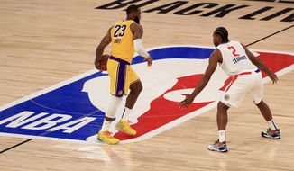 Los Angeles Lakers LeBron James (23) dribbles the ball against Los Angeles Clippers Kawhi Leonard (2) during the third quarter of an NBA basketball game Thursday, July 30, 2020, in Lake Buena Vista, Fla. (Mike Ehrmann/Pool Photo via AP)