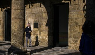 FILE - In this Nov. 23, 2018 file photo, Havana City Historian Eusebio Leal Spengler walks in the courtyard of the City Museum in Havana, Cuba. Leal, who oversaw the transformation of crumbling Old Havana to an immaculately restored colonial tourist attraction, becoming the de-facto mayor of the historic city center and one of the nation's most prominent public intellectuals, has died according to state media on Friday, July 31, 2020, after a long battle with cancer. (AP Photo/Desmond Boylan, File)