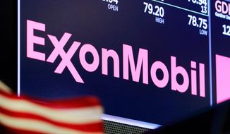 In this April 23, 2018, file photo, the logo for ExxonMobil appears above a trading post on the floor of the New York Stock Exchange. Exxon lost $1.1 billion in the second quarter, Friday, July 31, 2020, its economic pain deepening as the pandemic kept households on lockdown, diminishing the need for oil around the world.  (AP Photo/Richard Drew, File)