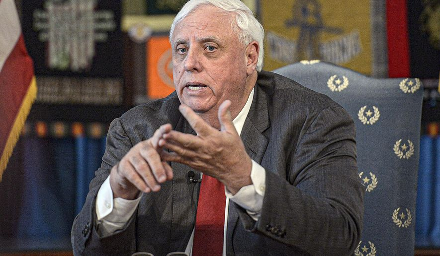 FILE - In this March 12, 2020, file photo, West Virginia Gov. Jim Justice speaks during a press conference at the State Capitol in Charleston, W.Va. Ben Salango, the Democratic candidate for West Virginia governor on Friday, July 31, 2020, said that he has agreed to debate Gov. Jim Justice five times before the November election and called on the Republican incumbent to sign on as well. (F. Brian Ferguson/Charleston Gazette-Mail via AP)