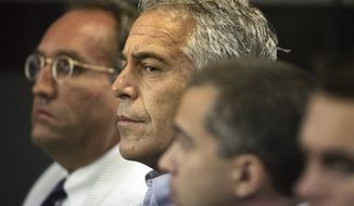In this July 30, 2008, file photo, Jeffrey Epstein appears in court in West Palm Beach, Fla.  Newly unsealed court documents provide a fresh glimpse into a fierce civil court fight between Epstein's ex-girlfriend, Ghislaine Maxwell, and one of the women who accused the couple of sexual abuse. The documents released Thursday, July 30, 2020, were from a now-settled defamation lawsuit filed by one of Epstein's alleged victims, Virginia Roberts Giuffre. (Uma Sanghvi/Palm Beach Post via AP, File)