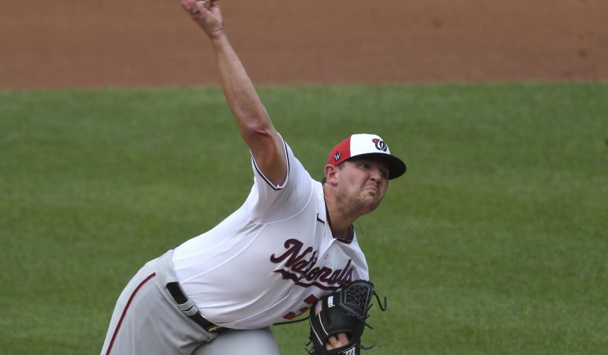 Washington National pitcher Will Harris delivers a pitch during an intersquad baseball game at Nationals Park in Washington, Friday, July 17, 2020. (AP Photo/Susan Walsh)