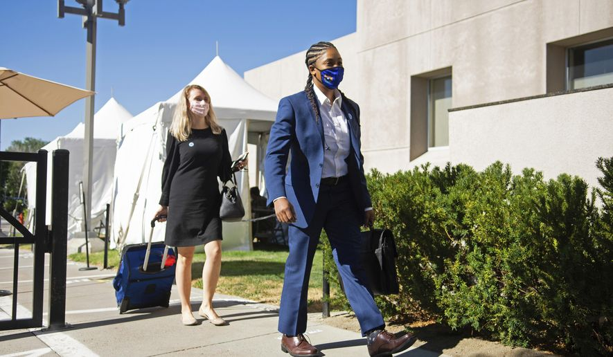 State Senators Dallas Harris, right, and Melanie Scheible arrive at the Legislature on Friday, July 31, 2020 during the first day of the 32nd Special Session of the Legislature in Carson City. Gov. Steve Sisolak convened the Nevada Legislature on Friday for a special session to address policy issues related to the coronavirus pandemic and Black Lives Matter protests that swept Nevada and the nation in May and June. b (David Calvert/Nevada Independent via AP, Pool)