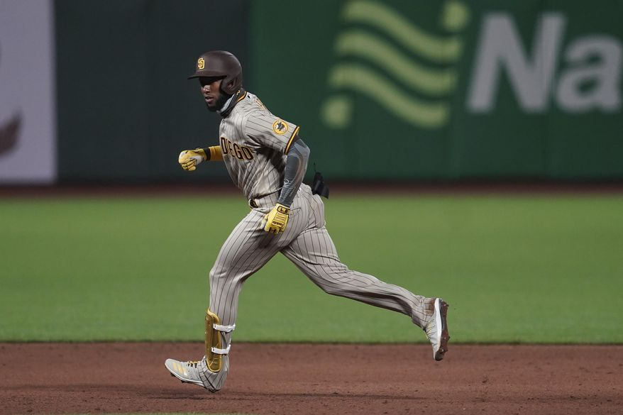 San Diego Padres' Jurickson Profar rounds the bases after hitting a two-run home run against the San Francisco Giants during the sixth inning of a baseball game in San Francisco, Thursday, July 30, 2020. (AP Photo/Jeff Chiu)