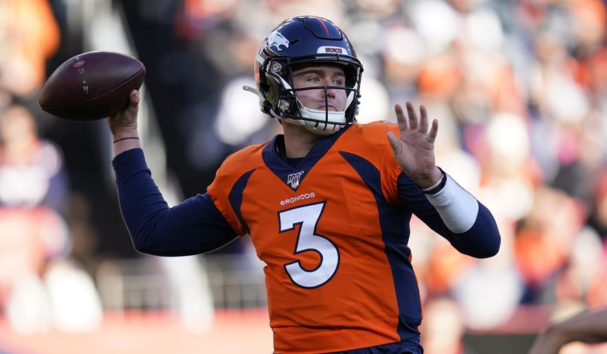 "FILE - In this Dec. 29, 2019, file photo, Denver Broncos quarterback Drew Lock throws a pass during the first half of an NFL football game against the Oakland Raiders in Denver.  John Elway says expectations for Lock this season are ""definitely tempered"" by the effects of the coronavirus that scuttled the regular offseason and all preseason games(AP Photo/Jack Dempsey, File)"