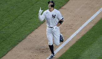 New York Yankees' Aaron Judge reacts as he approaches home plate after hitting a two-run home run during the third inning of the baseball game against the Boston Red Sox at Yankee Stadium, Friday, July 31, 2020, in New York. (AP Photo/Seth Wenig)