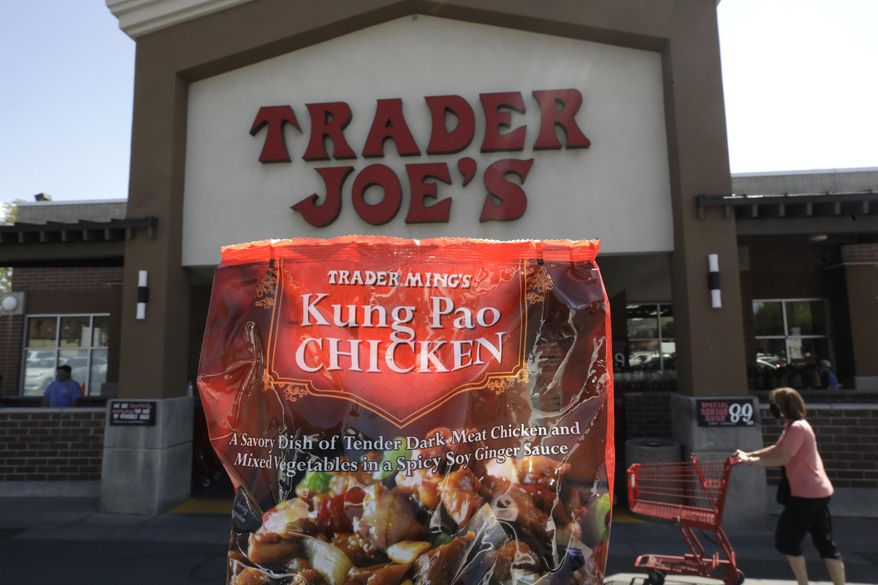 Trader Ming's Kung Pao Chicken is shown in from of Trader Joe's Friday, July 31, 2020, in Salt Lake City. The popular grocery chain Trader Joe's says it won't be changing ethnic-sounding labels on its line of Mexican, Chinese and other international foods, adding they are not racist. Earlier this month the company said it was looking at changing some labels. But now it says it has no problem with ethnic-food labels like Trader Jose's, Trader Ming's and Arabian Joe. (AP Photo/Rick Bowmer)