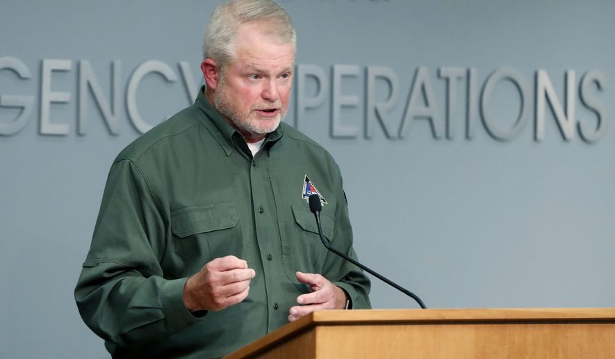 N.C. Director of Emergency Management Mike Sprayberry answers a question during an update on North Carolina's preparations for Hurricane Isaias at the Emergency Operations Center in Raleigh, N.C., Friday, July 31, 2020. (Ethan Hyman/The News & Observer via AP)