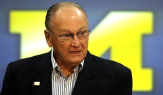 FILE - in this Nov. 13, 2006 file photo, former Michigan head football coach Bo Schembechler talks to the media in Ann Arbor, Mich. Dozens of more victims who claim they were molested by a University of Michigan doctor filed a lawsuit against the school Thursday, July 30, 2020, including a former football player who said he told legendary coach Bo Schembechler about the abuse in the early 1980s. (Mandi Wright/Detroit Free Press via AP)
