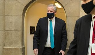 White House Chief of Staff Mark Meadows, arrives with Treasury Secretary Steven T. Mnuchin at the office of House Speaker Nancy Pelosi at the Capitol to resume talks on a COVID-19 relief bill, Saturday, Aug. 1, 2020, in Washington. (AP Photo/Manuel Balce Ceneta)