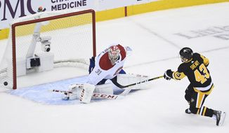 Pittsburgh Penguins left wing Conor Sheary (43) gets stopped on a penalty shot by Montreal Canadiens goaltender Carey Price (31) during the third period of an NHL hockey playoff game in Toronto, Saturday, Aug. 1, 2020. (Nathan Denette/The Canadian Press via AP)