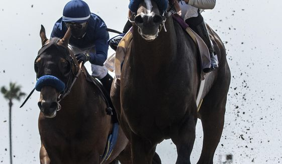 In this image provided by Benoit Photo, Thousand Words, right, with Abel Cedillo aboard, outlegs Cezanne, left, with Flavien Prat aboard, to win the $100,000 Shared Belief Stakes horse race Saturday, Aug. 1, 2020, at Del Mar Thoroughbred Club in Del Mar, Calif. (Benoit Photo via AP)