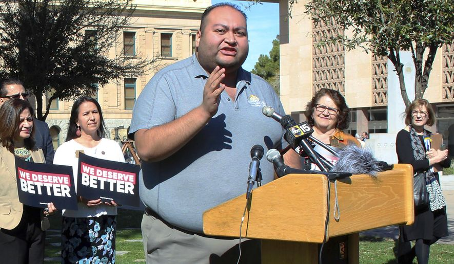 FILE - In this March 12, 2018 file photo, Arizona State Rep. Daniel Hernandez, a Tucson Democrat, speaks during a news conference at the state Capitol in Phoenix. With Democrats eyeing November pickups they hope will give them control of the Arizona Legislature for the first time in decades, business interests are pumping cash into their primaries. But the biggest knock-down, drag-out primary fight pits two sitting lawmakers in a Republican north Phoenix district battling for the soul of the GOP base. (AP Photo/Bob Christie, File)