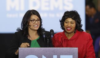 In an Oct. 26, 2018, file photo, Rashida Tlaib, left, then-Democratic candidate for Michigan's 13th Congressional District, and Brenda Jones speak during a rally in Detroit. (AP Photo/Paul Sancya, File)