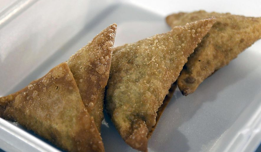 """Sambusa, a Somali meat pie filled with ground beef and spices, is shown at J's Sambusa, a new Somali restaurant Monday, July 26, 2020 in North Mankato, Minn. Before Nasra """"Jamila"""" Ibrahim emigrated to the United States from Somalia in 1994, she worked at her brother's restaurant in Mogadishu. Ever since then, the idea of opening a restaurant of her own has lingered in the back of her mind. (Pat Christman/The Free Press via AP)"""