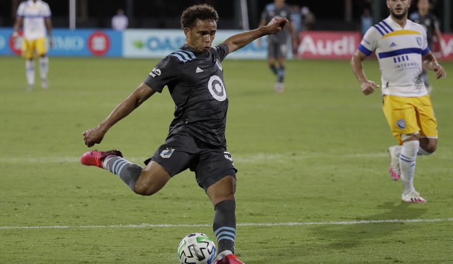 Minnesota United midfielder Hassani Dotson shoots against the San Jose Earthquakes during the second half of an MLS soccer match, Saturday, Aug. 1, 2020, in Kissimmee, Fla. (AP Photo/John Raoux)