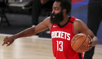 Houston Rockets James Harden (13)  dribbles the ball against the Dallas Mavericks during the second half of an NBA basketball game Friday, July 31, 2020, in Lake Buena Vista, Fla. (Mike Ehrmann/Pool Photo via AP)