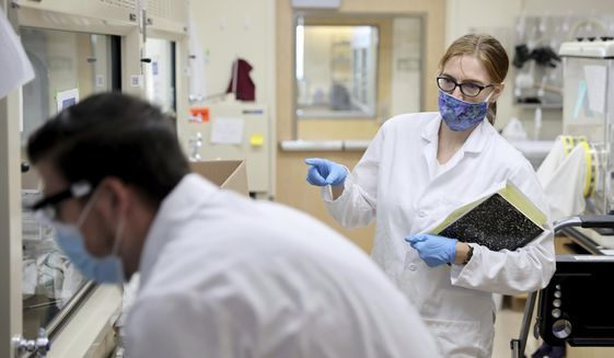 """UNLV professor Elisabeth """"Libby"""" Hausrath works with Ph.D. student Anthony Feldman in her lab on campus in Las Vegas Friday, July 24, 2020. Hausrath is one of 10 scientists selected by NASA to study the soil and rock samples from Mars. (K.M. Cannon/Las Vegas Review-Journal via AP)"""