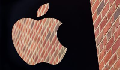 The Apple logo is shown on a sign hanging in front of a new Apple Store, Thursday, July 28, 2016, in the Williamsburg section in the Brooklyn borough of New York. The store opens to the public Saturday. (AP Photo/Mark Lennihan)