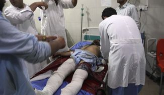 A wounded man receives treatment at a hospital after a suicide car bomb and multiple gunmen attack in the city of  Jalalabad, east of Kabul, Afghanistan, Sunday, Aug. 2, 2020. A suicide car bomb and multiple gunmen attacked a prison in eastern Afghanistan on Sunday, Afghan officials said, killing at least one person and injuring dozens. (AP Photo)