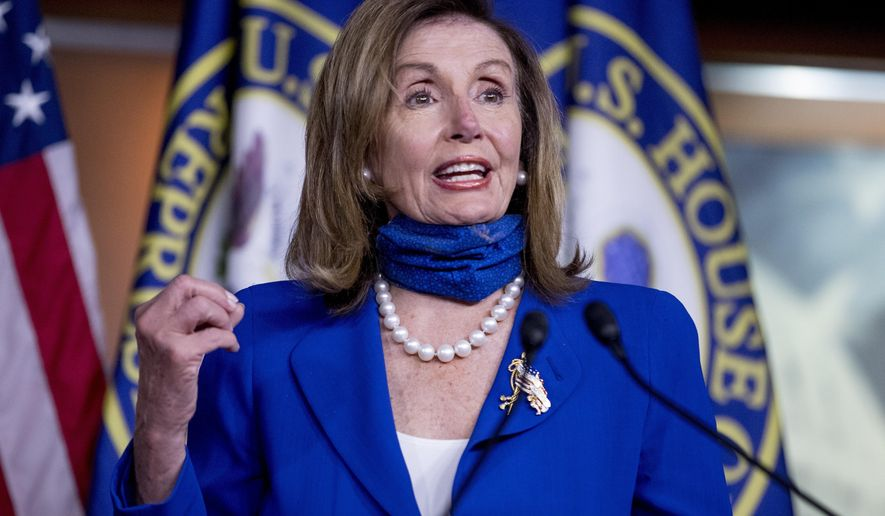 FILE - In this July 29, 2020, file photo House Speaker Nancy Pelosi of Calif. speaks at a press conference on Capitol Hill in Washington. This election year's battle for control of the House is once again hinging heavily on a fight over suburban voters.  Democrats boast an ever-expanding target list that includes a half-dozen Republican seats in Texas plus others outside Atlanta, Cincinnati, Los Angeles and Phoenix. (AP Photo/Andrew Harnik, File)