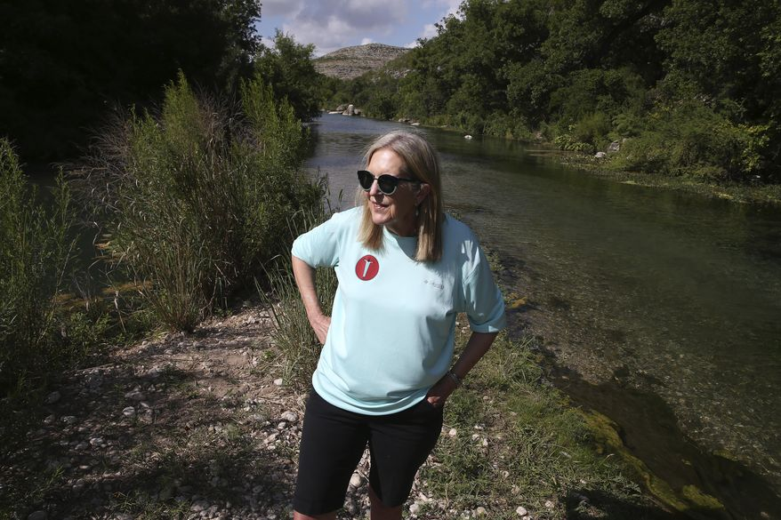 Alice Strunck visits the site of natural springs that feed the Devils River on her family's Hudspeth River Ranch in Val Verde County north of Comstock, Texas, Tuesday, June 16, 2020. Her family has owned the ranch since 1905 and encompasses part of the Devils River and several springs that feed it. (Jerry Lara/The San Antonio Express-News via AP)