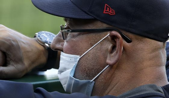 Cleveland Indians manager Terry Francona stands in the dugout during an exhibition baseball game against the Pittsburgh Pirates in Pittsburgh, Saturday, July 18, 2020. (AP Photo/Gene J. Puskar)