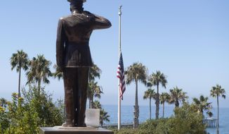 FILE - The U.S. flag was lowered to half-staff at Park Semper Fi in San Clemente, Calif., on Friday, July 31, 2020. Eight troops aboard a landing craft that sank off the Southern California coast during a training exercise are presumed dead, the Marine Corps announced Sunday, Aug. 2, 2020. The Marines said they had called off the search that started late Thursday afternoon when the amphibious assault vehicle sank with seven Marines and one sailor aboard. (Paul Bersebach/The Orange County Register via AP, file)