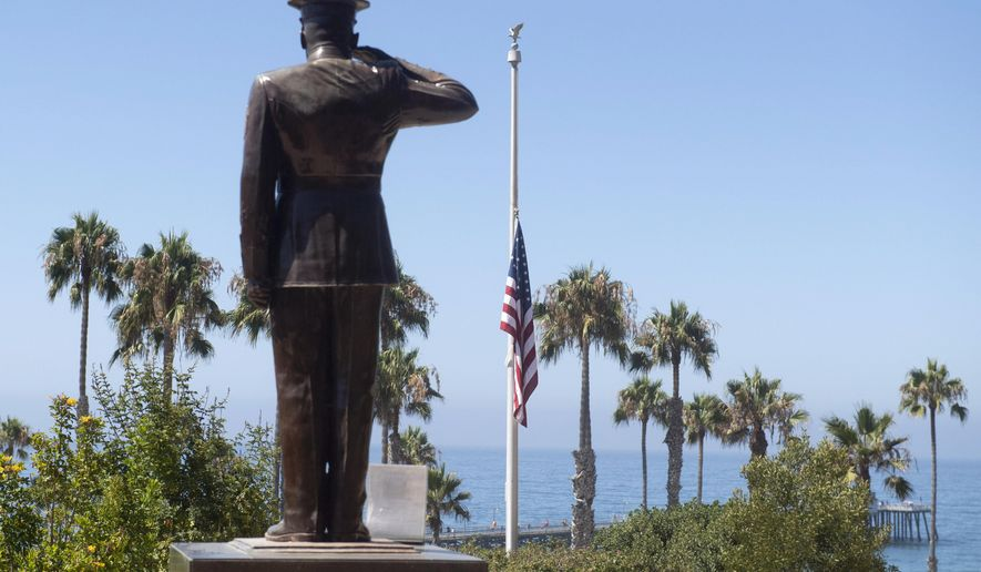 In this file photo, the U.S. flag was lowered to half-staff at Park Semper Fi in San Clemente, Calif., on Friday, July 31, 2020. The day before, seven Marines and one sailor died aboard a landing craft that sank off the Southern California coast. Their bodies were recovered days later after an extensive search. (Paul Bersebach/The Orange County Register via AP, file) **FILE**