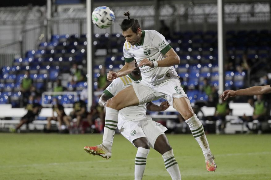 Portland Timbers midfielder Diego Valeri heads the ball against the New York City during the second half of an MLS soccer match, Saturday, Aug. 1, 2020, in Kissimmee, Fla. (AP Photo/John Raoux)