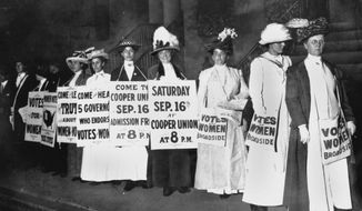 FILE - In this September 1916 file photo, demonstrators hold a rally for women's suffrage in New York. The Seneca Falls convention in 1848 is widely viewed as the launch of the women's suffrage movement, yet women didn't gain the right to vote until ratification of the 19th Amendment in 1920. (AP Photo)
